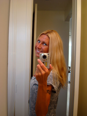 Woman taking picture of new haircut