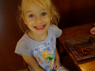 Young girl smiling eating at table