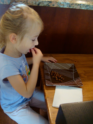 Young girl eating a plate of Carmelized Cinnamon Sugar Roasted Chickpea Peanuts