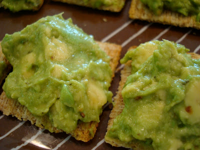 Two crackers spread with Homemade Guacamole