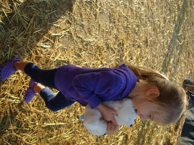 Young girl hugging stuffed animal