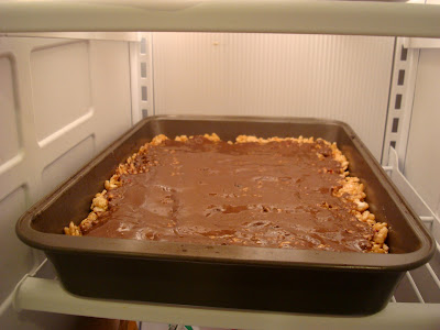 """GF Vegan """"Rice Krispie"""" Treats with Chocolate Peanut Butter Coconut Oil Frosting placed in refrigerator"""