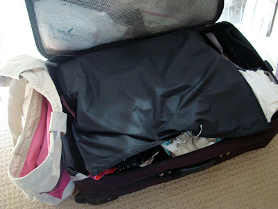 Open suitcase fully packed