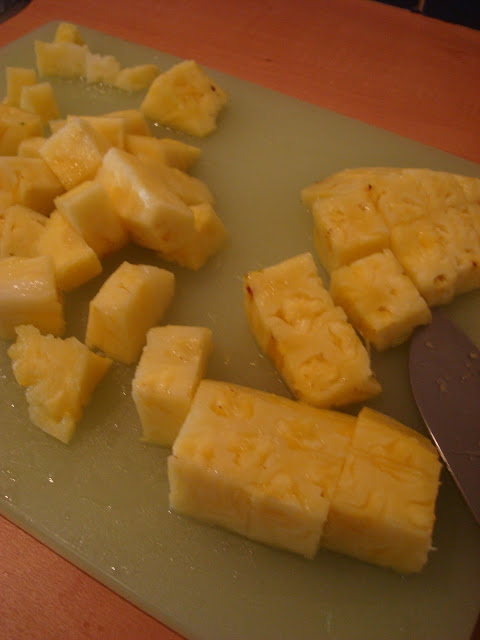 Diced up pineapple on cutting board