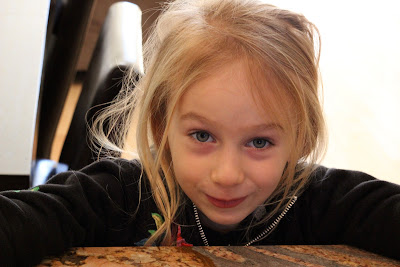 Young girl leaning over countertop