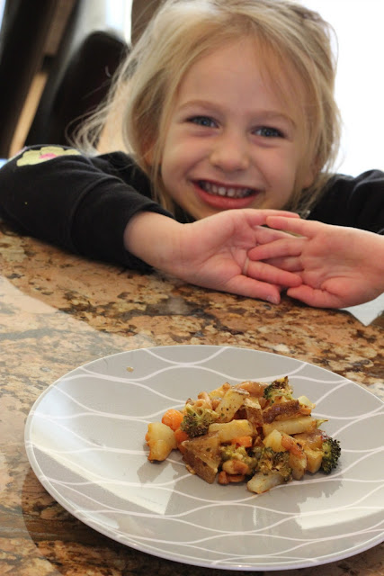 Young girl in front of plate of Cheezy Vegetable Bake