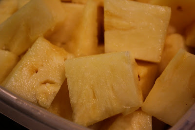 Pineapple slices in container