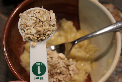 oats being adding to mashed banana