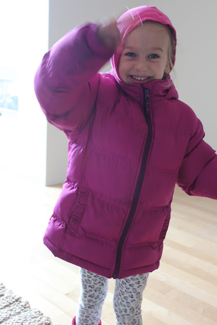 Close up of young girl in jacket with arm raised