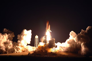 NASA shuttle sts123 launches at night