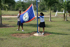 Raising the Belize Flag