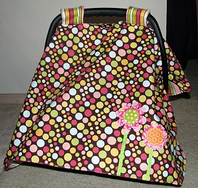 Have you seen those really cute car seat blanket/tent/canopy/whatever you