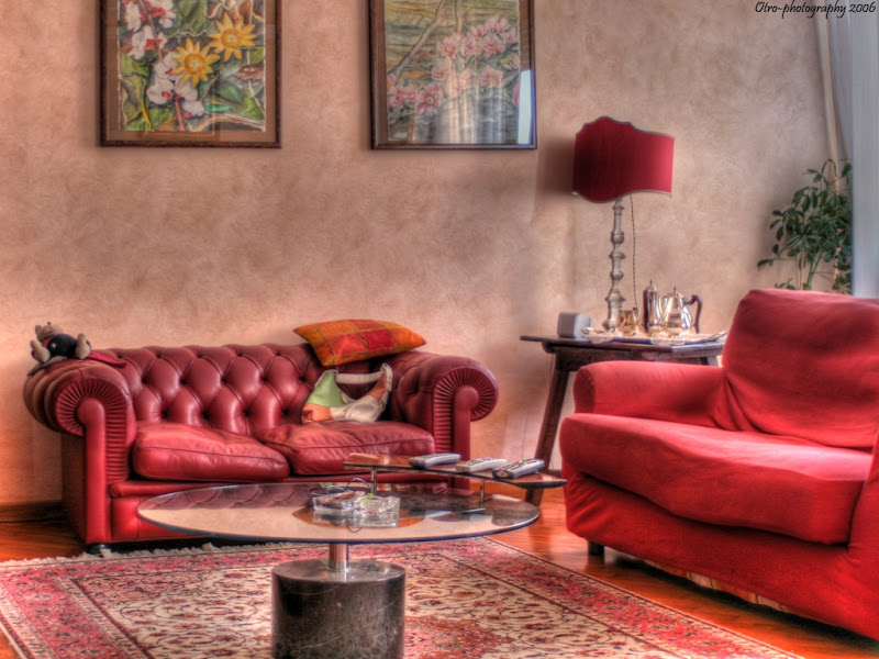 Living room with beautiful red design title=