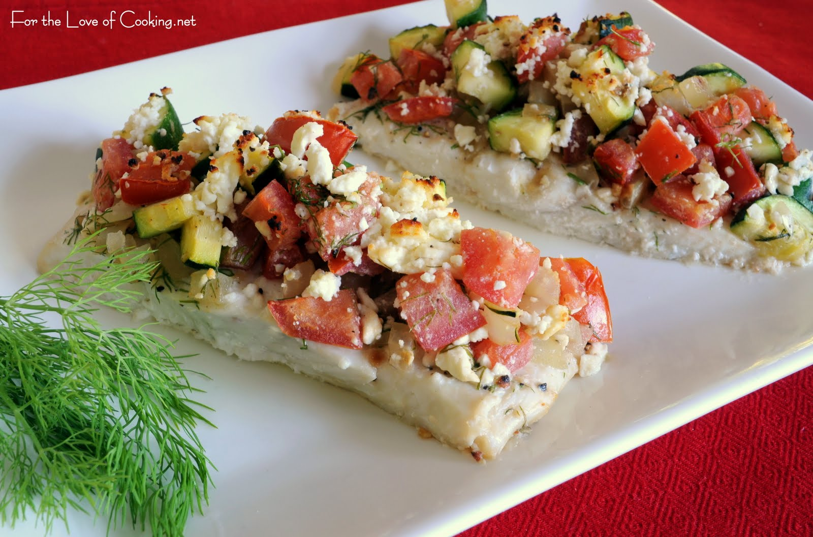 Baked halibut topped with zucchini tomato dill and feta for How to cook halibut fish