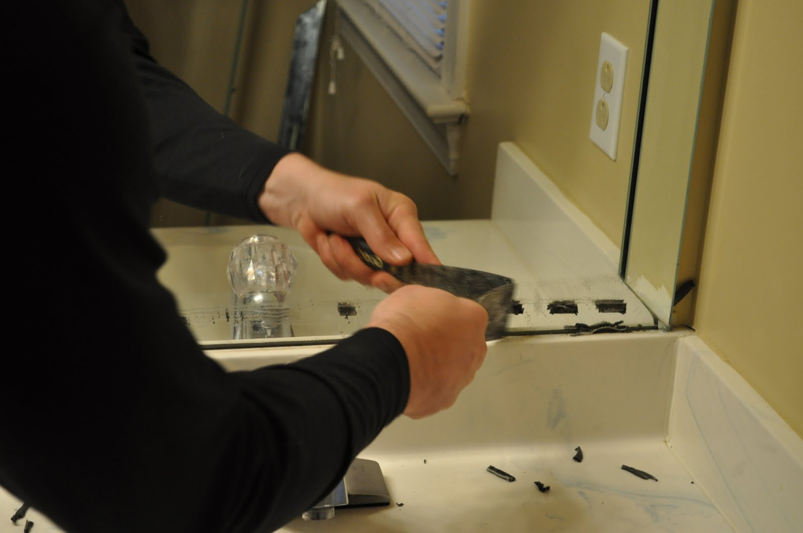 Removing bathroom mirror