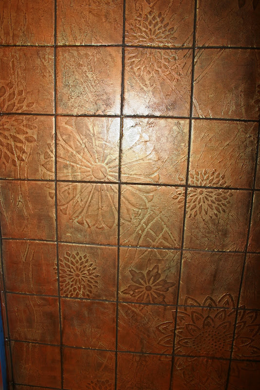 My Copper Tile Shower. Both projects over all white shiny tile, BTW. title=