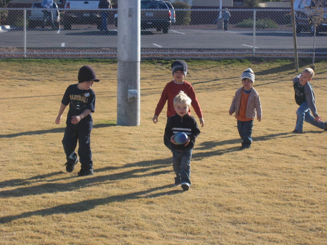 Kolton playing football at the ward activity