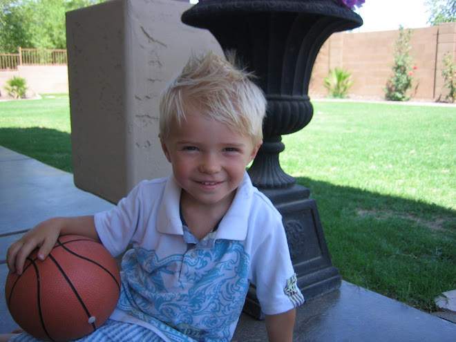Kolton playing basketball in the backyard