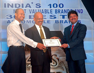 Prof A. Sandeep, Editor, Planman Media (left) & Mr. S. K. Shetty, Chairman & MD, Allcargo Global Logistics (right) giving away the Best Automobile Awards in the Two Wheeler Category to Mr. P. Sam, Group Head-Sales & Marketing, Yamaha Motor India (center)