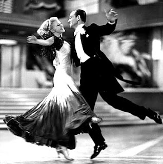 Ginger Rogers dancing with Fred Astaire backwards and in high heels