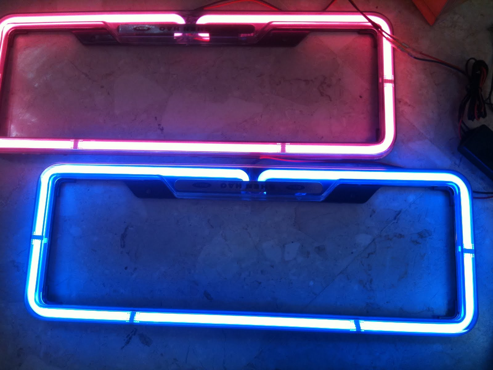 PLATE NUMBER FRAME W NEON LIGHT.
