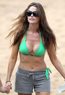 Denise Richards Looks Sporty In Green Bikini And Grey Shorts