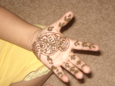2) my mehandi tattoo Arabic style.