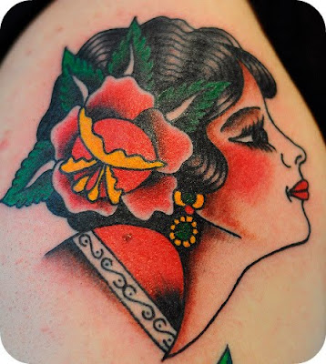the Virgrn de Guadeloupe done in a traditional American tattoo style: