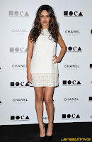 Mila Kunis in a white dress