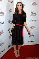 Eliza Dushku in a black dress at unknown event