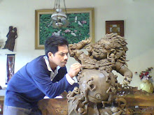 Ponimin working on his artwork - Against Evil