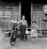 Three of the four [actually all four, plus cat] Arnold children. The oldest boy earned the money to buy his bicycle. Western Washington, Thurston County, Michigan Hill.