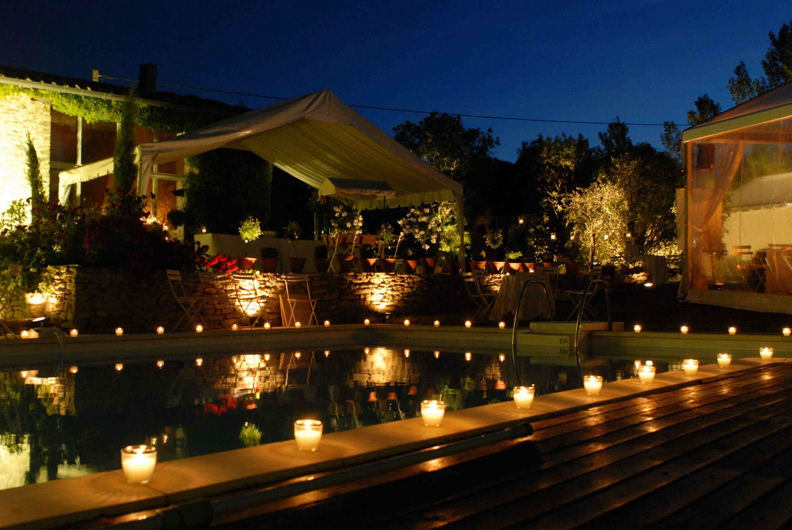 candles around a swimming pool