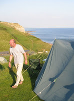 Mr A and our tent with the sea in the background