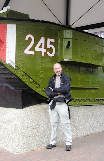 Mr A in front of a military tank