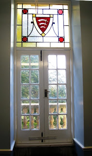 French door with stained glass panel of the Essex coat of arms