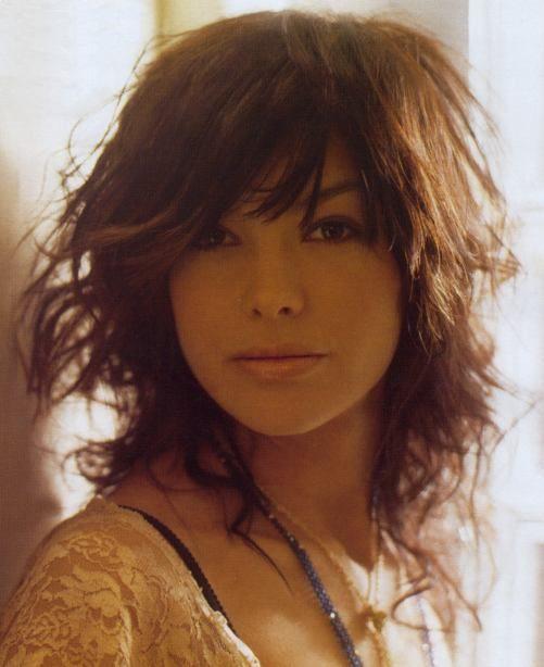 selena gomez hair short and curly. tattoo selena gomez curly hair