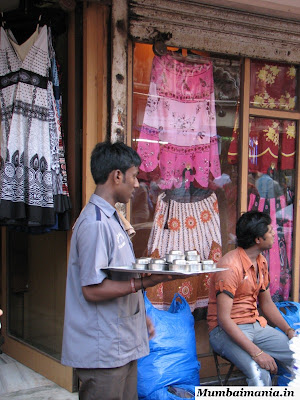 waiter giving tea at shops