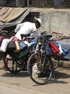 Dabbawalla sorting lunch boxes