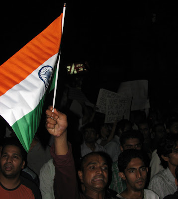 Supporters waving Indian flag protest rally