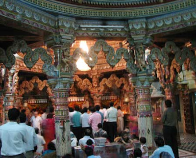 Devotees worshipping in Jain temple