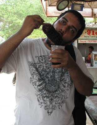 Clyde enjoying Kala khatta gola