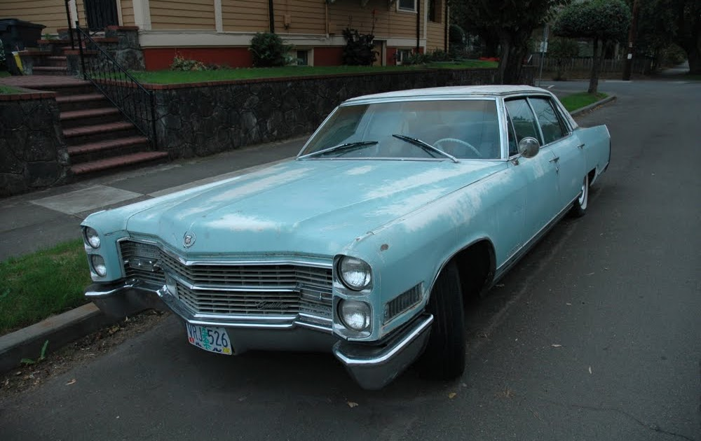 OLD PARKED CARS.: 1966 Cadillac Fleetwood Brougham.