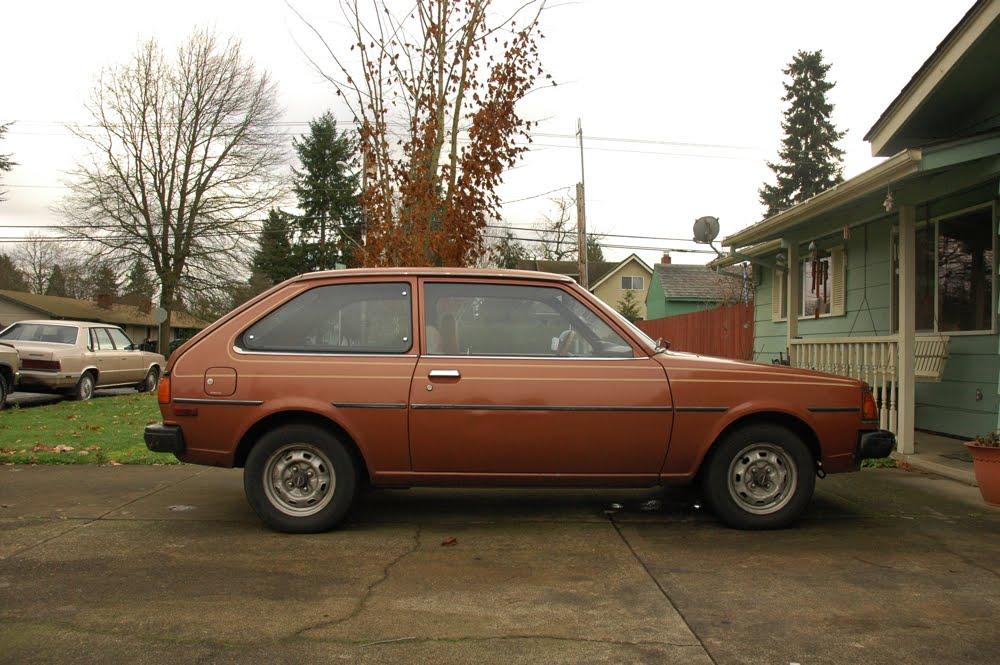 OLD PARKED CARS.: 1980 Mazda GLC.