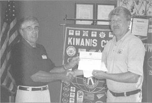 President Jim Higgs of the Hampstead Kiwanis Club Presenting a certificate of appreciation to Gary Schwarz of Pender Pines