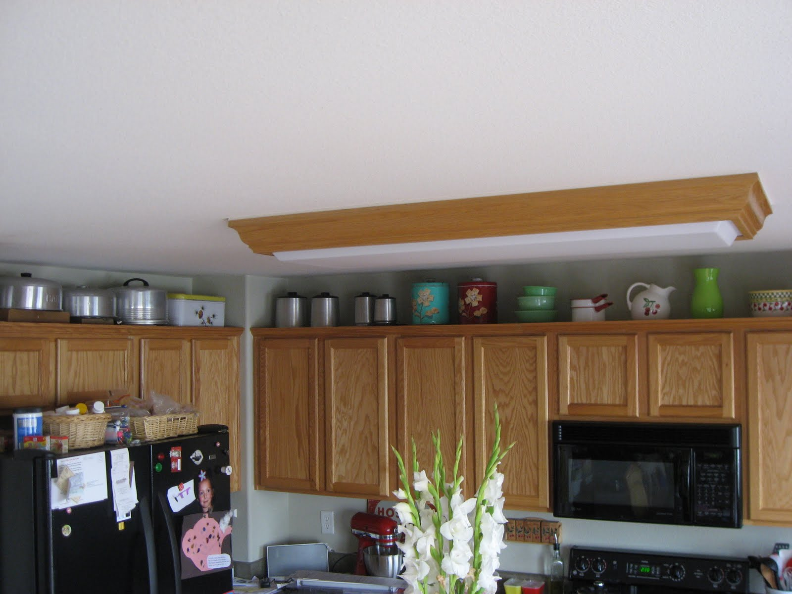 Decorating kitchen cabinets afreakatheart for On top of kitchen cabinet decorating ideas