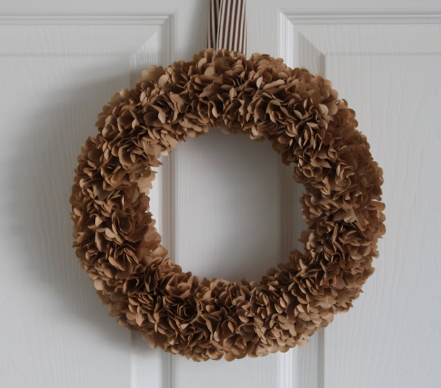 http://frauleinh.blogspot.ca/2010/08/crafty-stuff-paper-bag-wreath.html