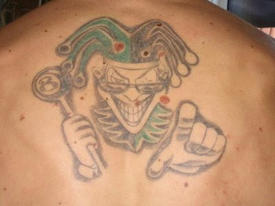 He had a Joker's Card influenced tattoo