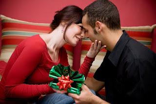 couple giving christmas gifts