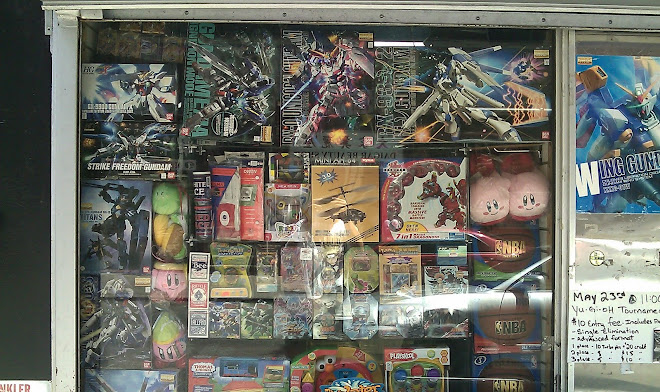 Gundam model kits from outside the shop.